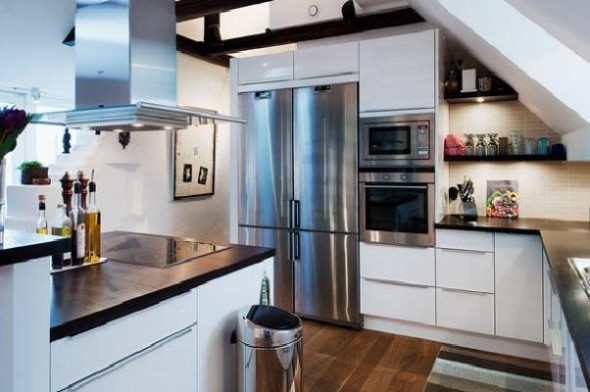 Design kitchen is a blissfully contemporary focal point on the upper level