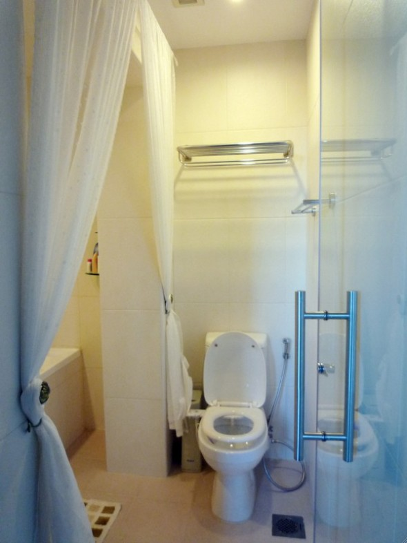 white toilet-Make Over Apartment
