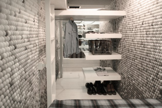 fitting room apartment with pingpong balls on walls