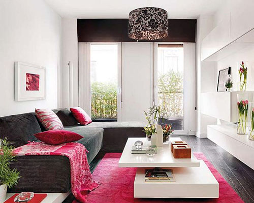 trendy sofa with pinky rug Incredible Duplex Apartment Madrid