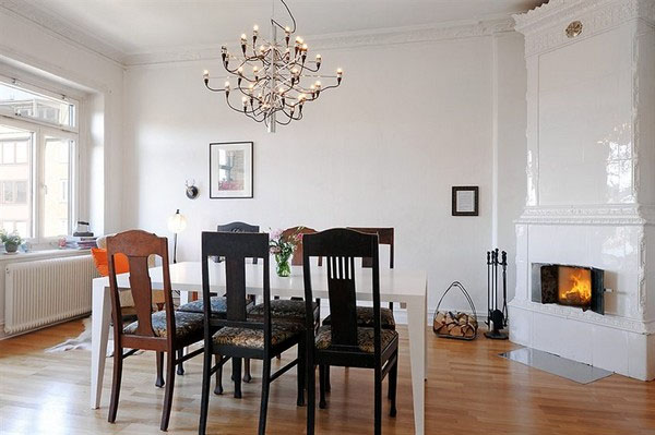 Interior of contemporary dining room with wood furniture are equipped with fireplace with Vintage Elements and Extreme Space