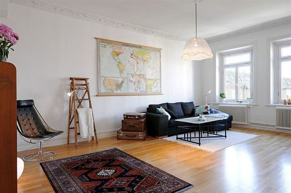 the living room is large, light and airy, featuring a comfortable sofa with Vintage Elements and Extreme Space