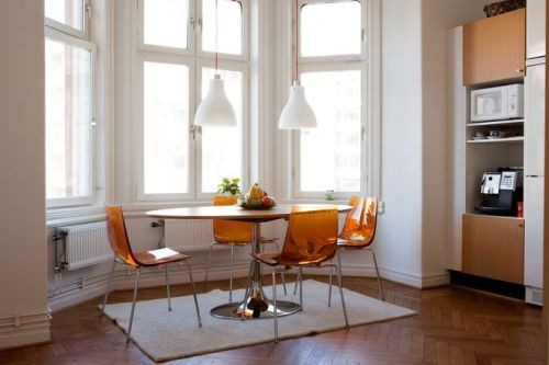 Apartment With Orange Chairs Interior
