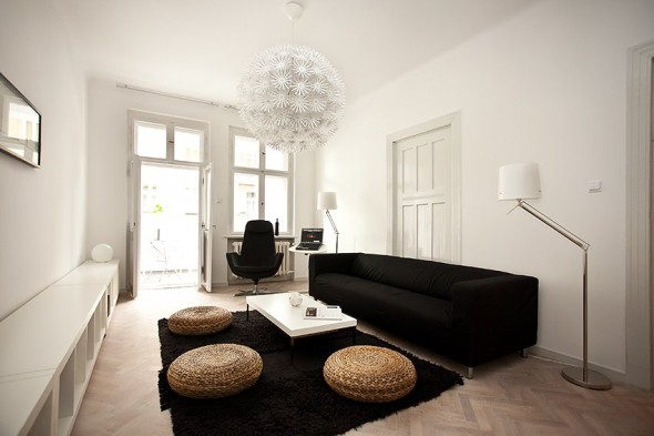 Black Living and simple access to outdoor - Small Polish Apartment Designs