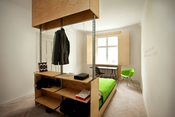 Clothes hanger and drawers for beds - Small Polish Apartment Designs